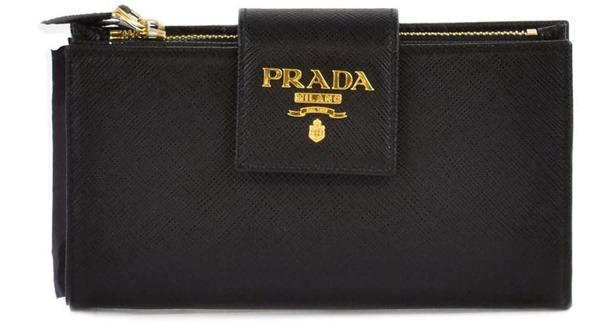 483eb86c17c4 ... low price lyst prada saffiano leather tab wallet in black e04dc faf9b