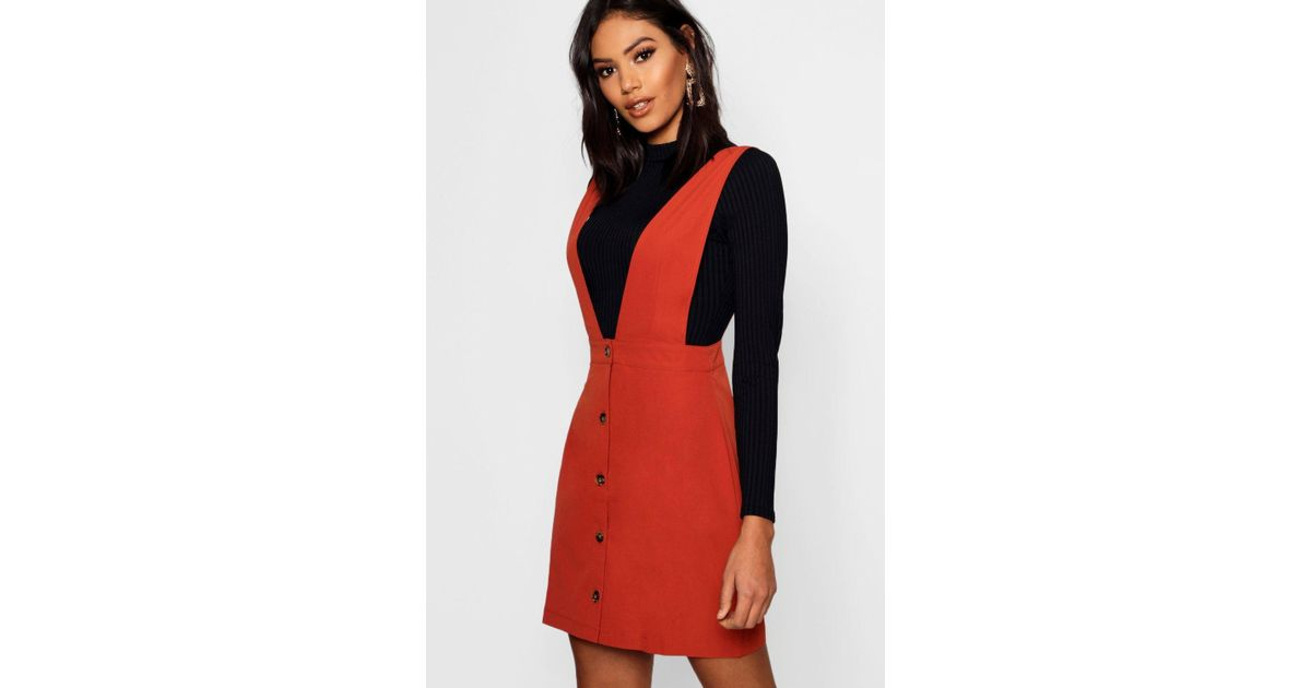 a36aebe8d9 Boohoo Plunge Front Button Pinafore Dress in Red - Lyst