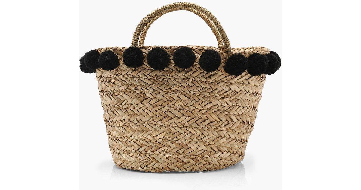 ae648feb04 Lyst - Boohoo Olivia Large Pom Pom Basket Bag in Natural