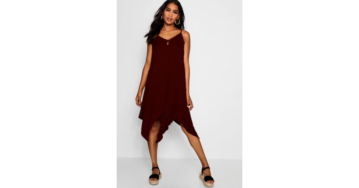 78879fe5aa75 Lyst - Boohoo Asymmetric Hem Strappy Swing Dress in Brown