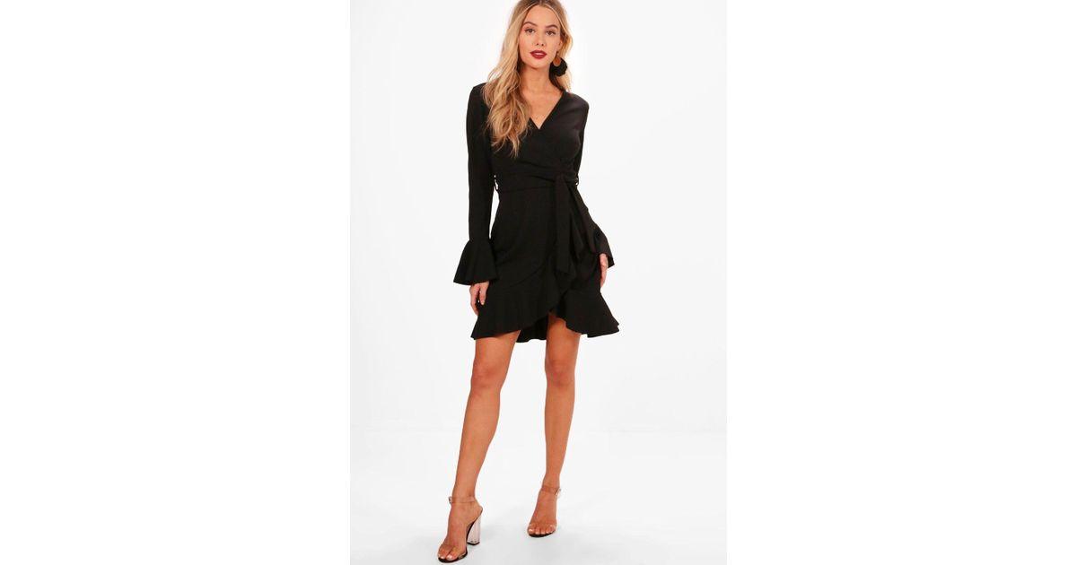 51e6be1030 Lyst - Boohoo Frill Sleeve Tie Waist Ruffle Hem Tea Dress in Black