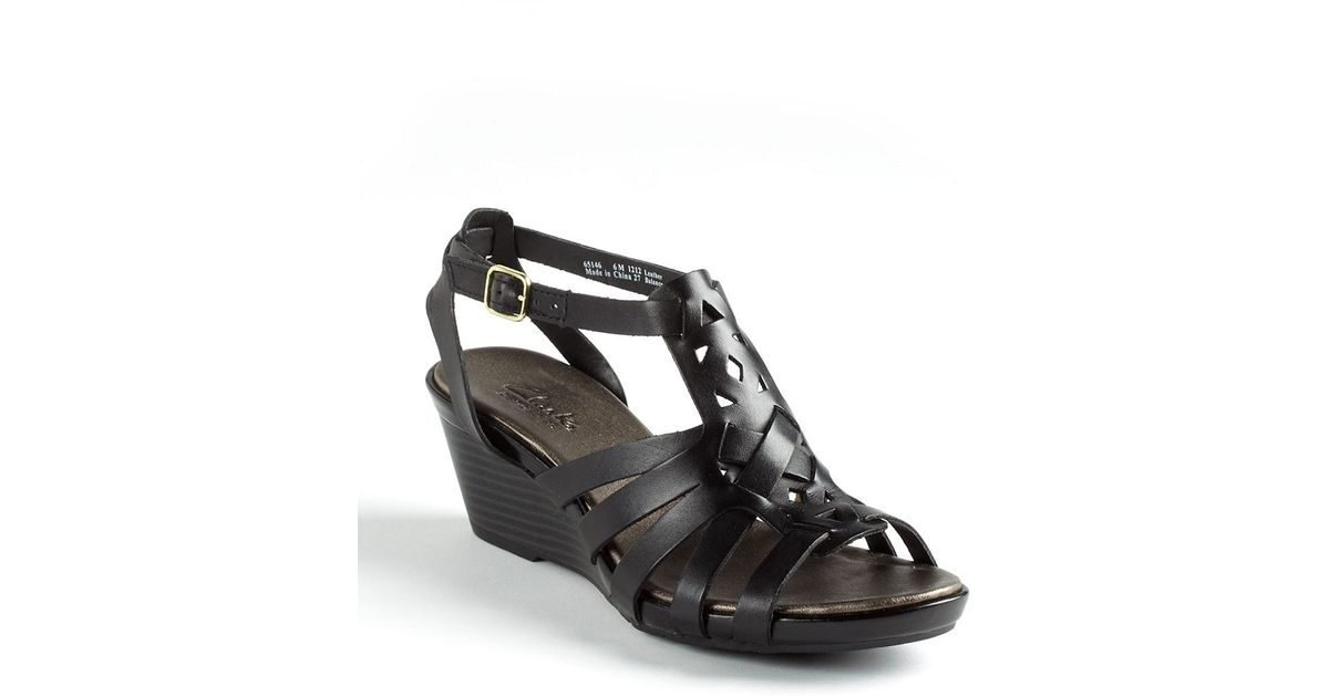 a7de8b32aca76c Clarks Lucia Coral Leather Wedge Sandals in Black - Lyst