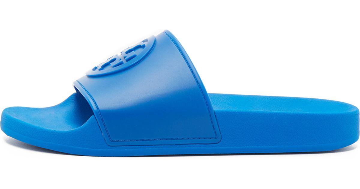 75f652cc804ac7 Lyst - Tory Burch Jelly Flat Slides in Blue