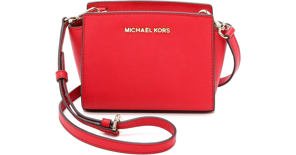 14876e6724fd Lyst - MICHAEL Michael Kors Selma Mini Messenger Bag - Pale Pink in Red