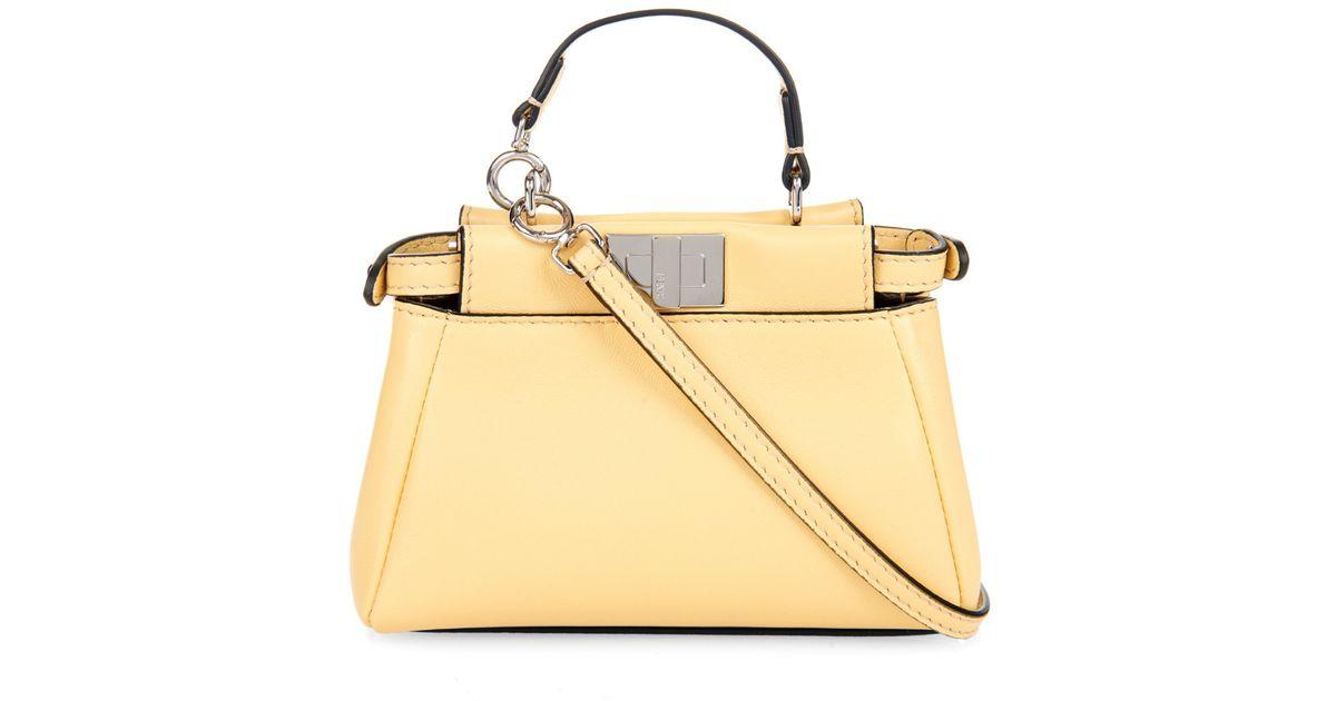 f6d76290ea Fendi Micro Peekaboo Leather Cross-Body Bag in Yellow - Lyst