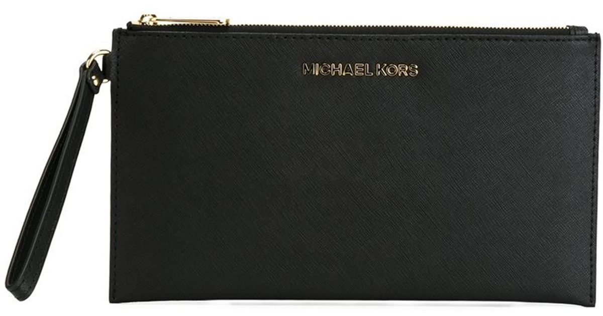 michael michael kors 39 bedford 39 wristlet clutch in black lyst. Black Bedroom Furniture Sets. Home Design Ideas