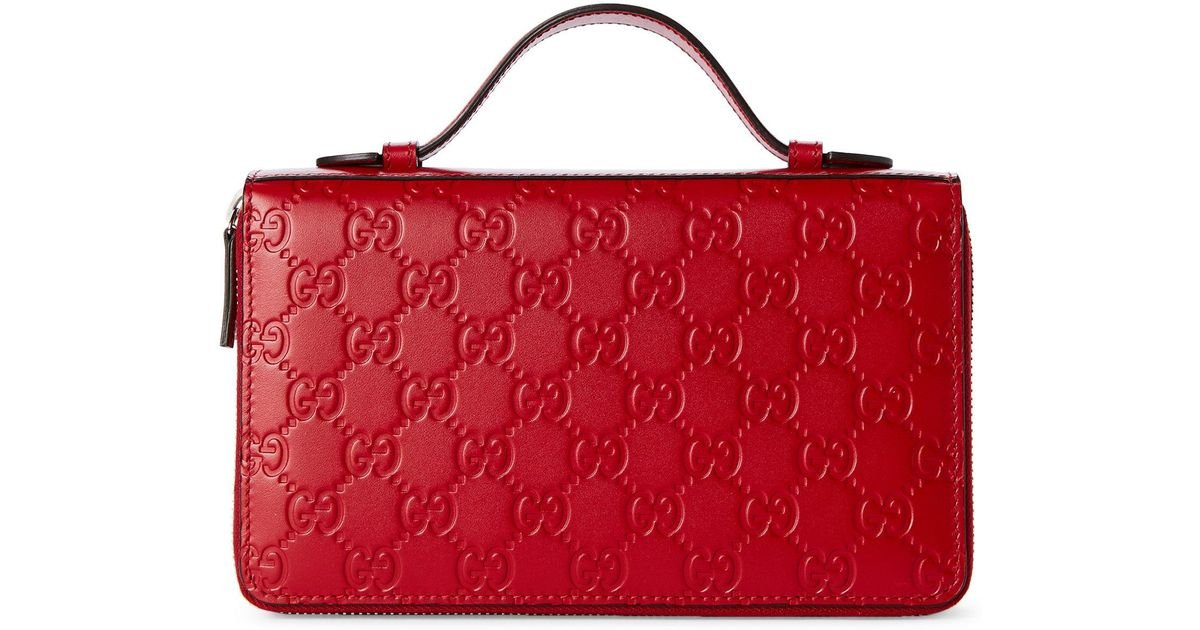5a078133 Gucci Red Gg Embossed Leather Travel Document Case in Red - Lyst