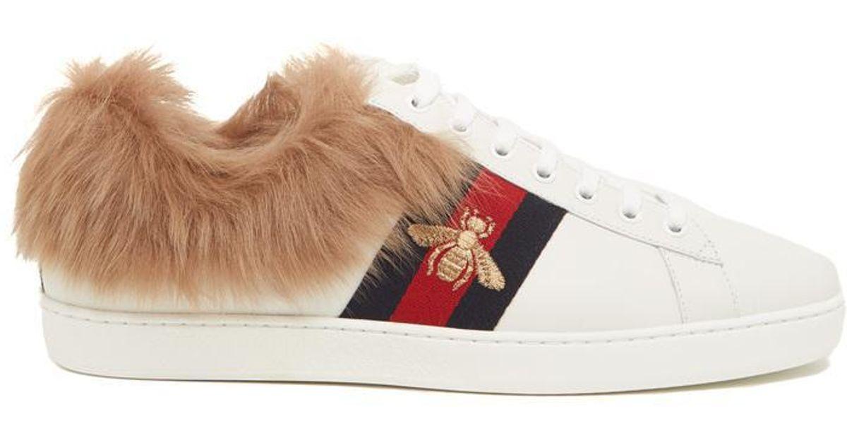 ae9c061e914 Lyst - Gucci Ace Fur Sneakers in White