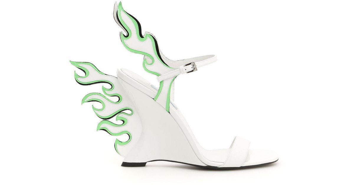 41a98fe9b66 Prada Flame Wedge Sandals in White - Lyst