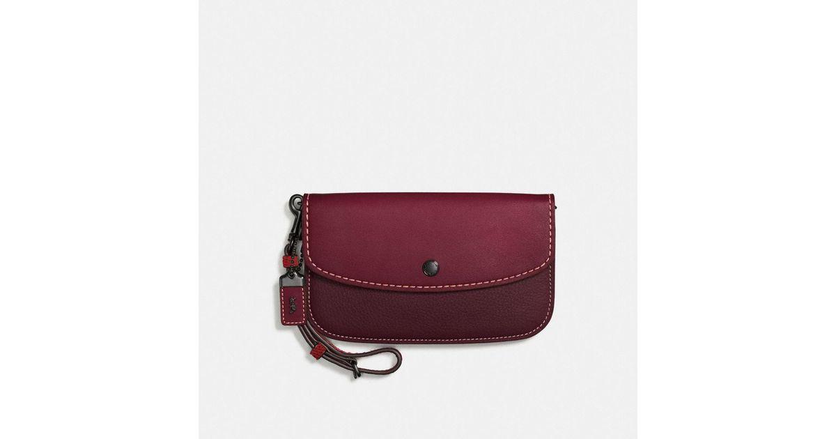 d47cd97dd055e Lyst - COACH Colorblock Snake Handle Clutch In Glovetanned Leather in Purple