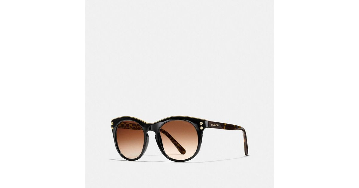 91be58497aad Lyst - COACH New York Round Sunglasses in Black