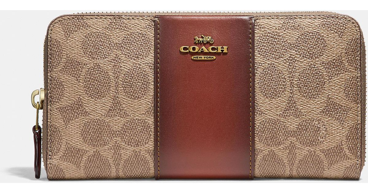 60fd1f43d34f9 Lyst - COACH Accordion Zip Wallet In Colorblock Signature Canvas in Brown