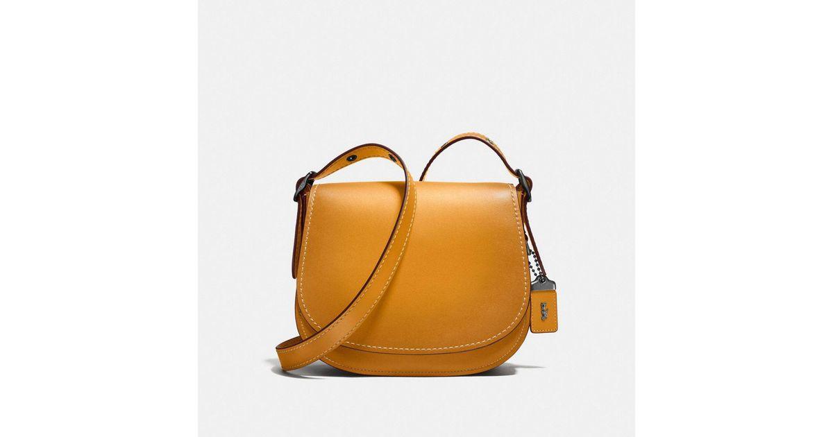 112cf8d38da Lyst - COACH Saddle Bag 23 In Glovetanned Leather in Black
