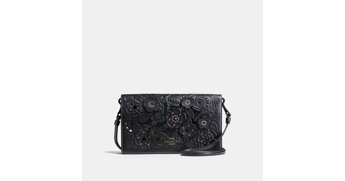 1c6360c5eafd9 Lyst - COACH Foldover Crossbody Clutch In Glovetanned Leather With Tea Rose  Tooling in Black