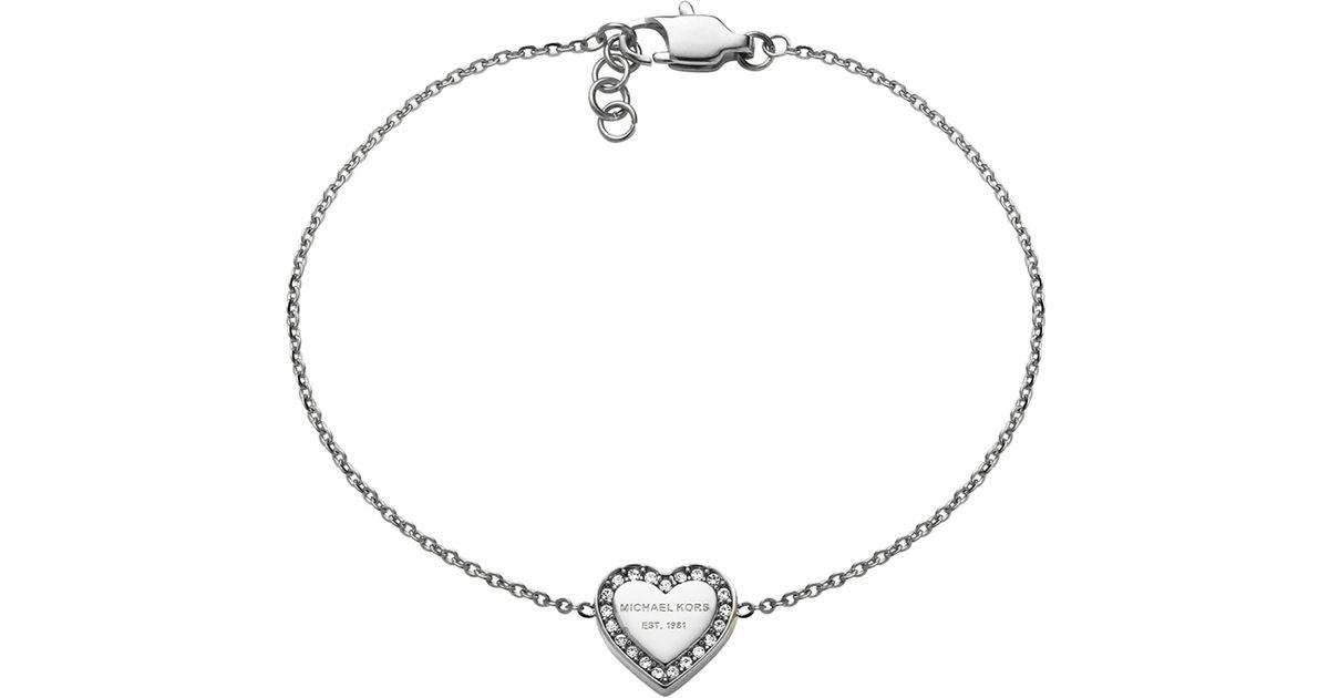 788a7b233caf7 Lyst - Michael Kors Silver Logo Heart Bracelet in Metallic