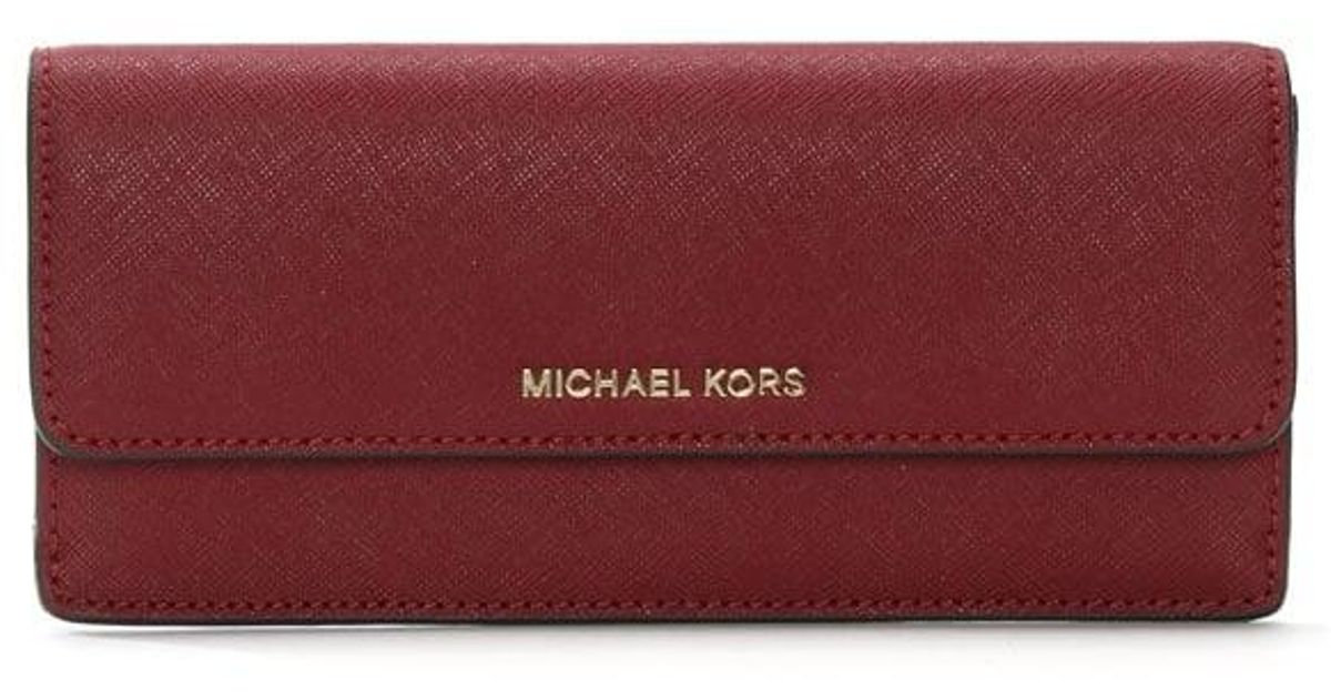 63dc6560d461 Michael Kors Jet Set Travel Mulberry Saffiano Leather Slim Wallet in Red -  Lyst