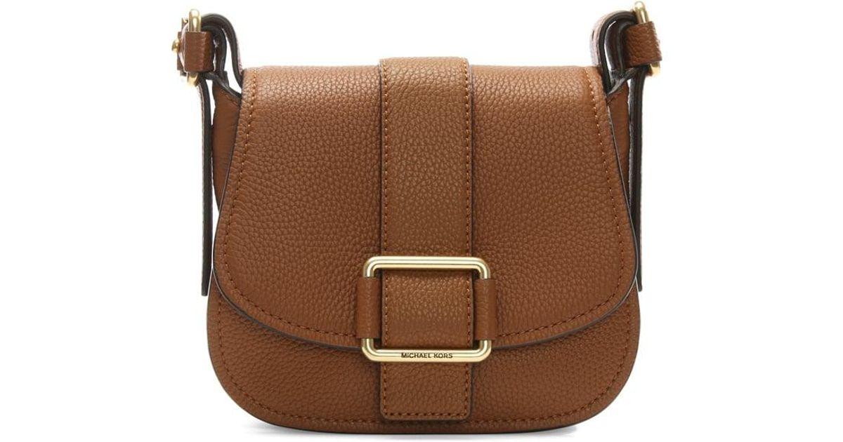d30f385b2cbb1 Lyst - Michael Kors Maxine Medium Luggage Leather Saddle Bag in Brown