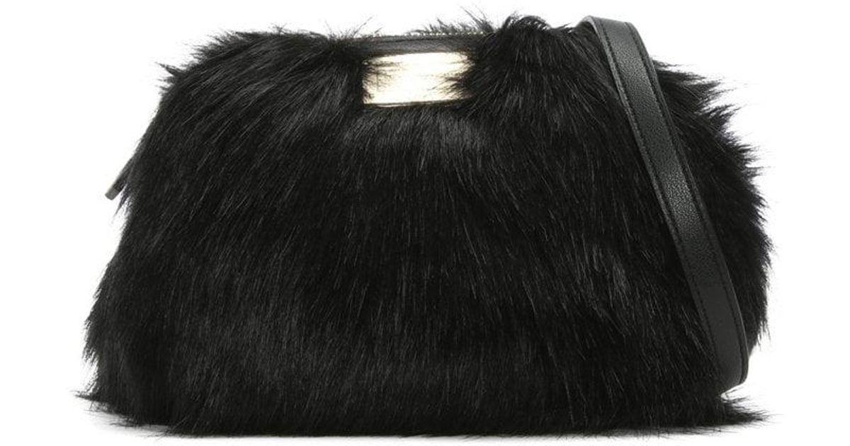 Lyst - Emporio Armani Furry Sling Black Faux Fur Cross-body Bag in Black 5bb5df25a1225