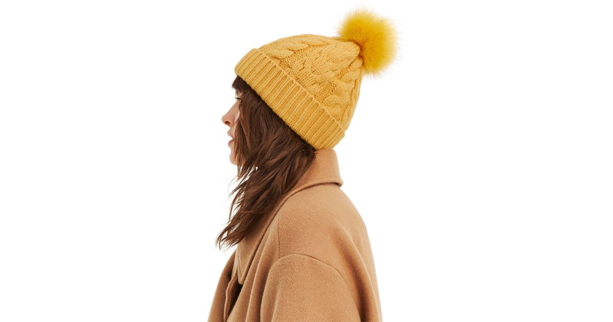 Oasis Cable Knit Beanie With Fur Pom Pom In Yellow in Yellow - Lyst a26df2e22e4