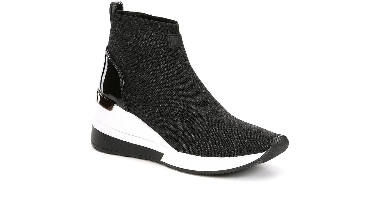 72d6c011f7d Lyst - MICHAEL Michael Kors Skyler Wedge Sneaker Booties in Black