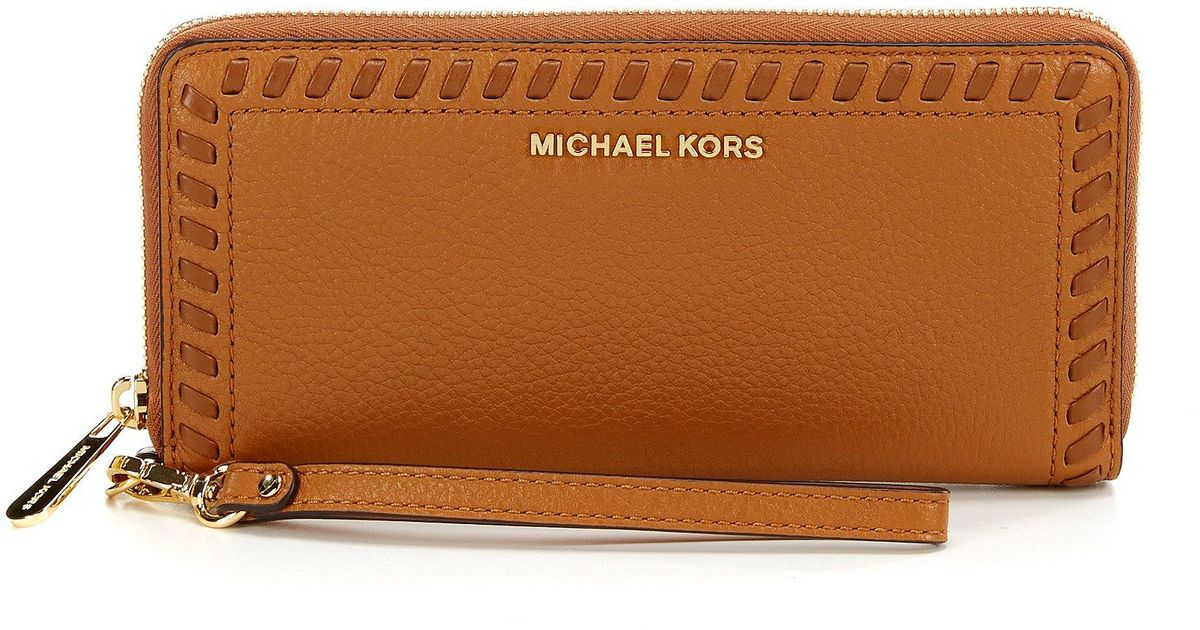 22ff3ef8efb9 Lyst - MICHAEL Michael Kors Lauryn Whip-stitched Continental Travel Wallet  in Brown