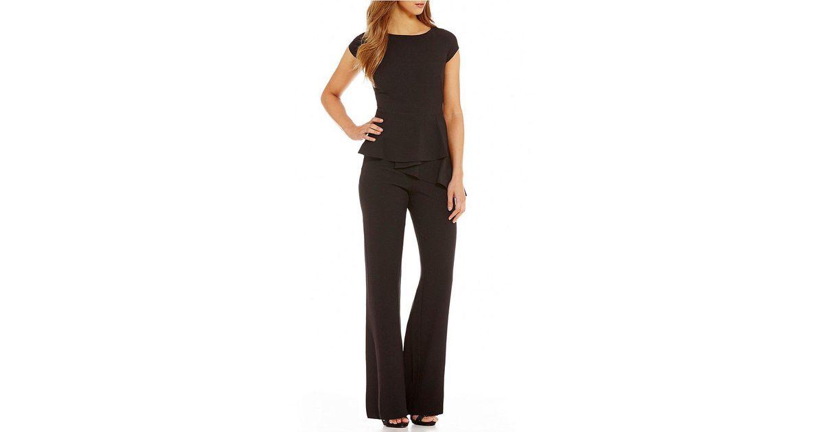 f52cfaf26291 Lyst - Eliza J Peplum Cap Sleeve Jumpsuit in Black