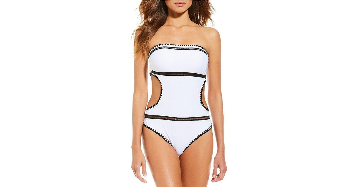 b4fcbffd3e2fa Lyst - Gianni Bini Barely Minimal Cut-out Bandeau High Leg One-piece  Swimsuit in White