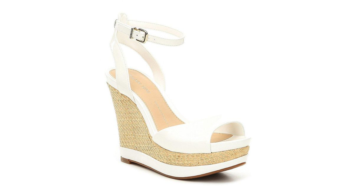 9a59bee16e0d Lyst - Gianni Bini Latoria Patent Leather Dress Wedges in White