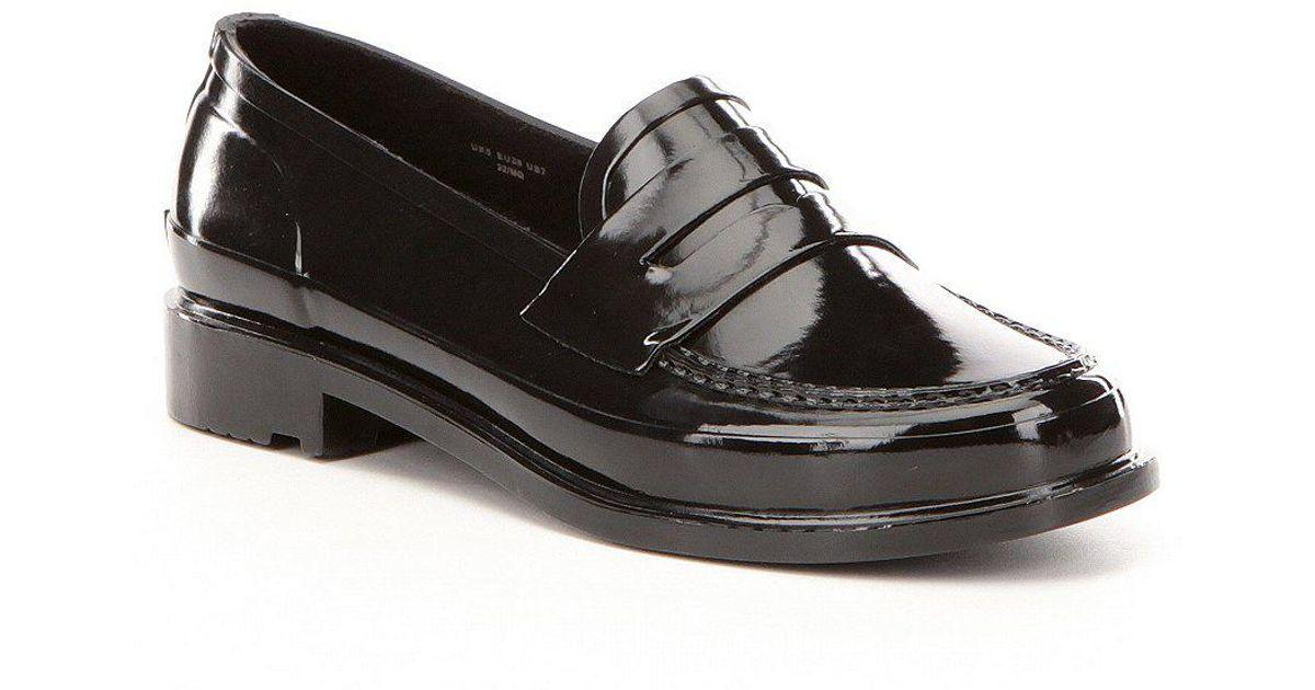 16754c8e6f5 Lyst - HUNTER Women s Original Short Waterproof Rubber Penny Loafers in  Black