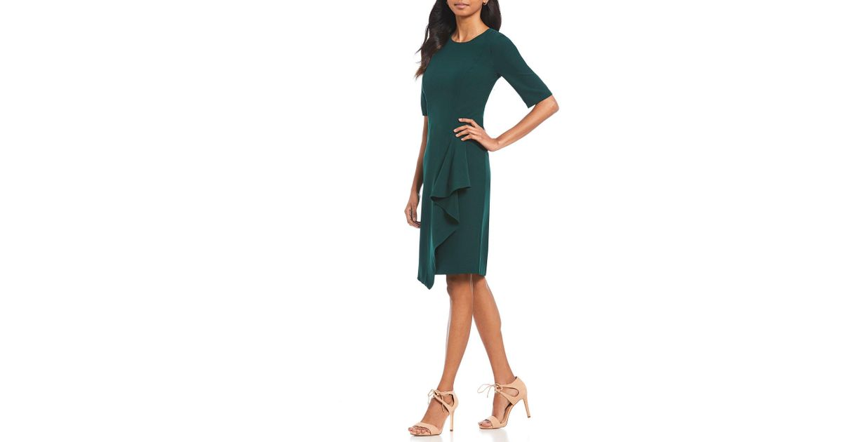 a80bcfc32e9 Lyst - Maggy London Ruffle Front Asymmetric Hem Crepe Sheath Dress in Green