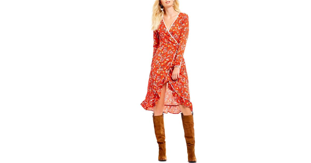 3747b5b430e73 Lyst - Free People Covent Garden Floral Print Ruffle Hem Hi-low Midi Length Wrap  Dress in Red