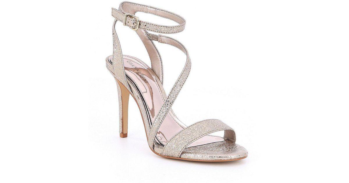 a1a6eec252a Lyst - Gianni Bini Evaleen Asymmetrical Dress Sandals in Metallic