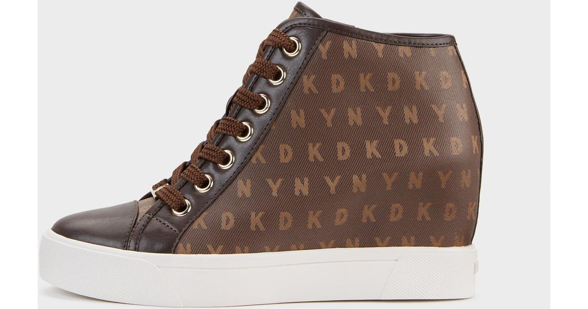638248bb983 Lyst - DKNY Cindy Logo Jacquard Wedge Sneaker in Brown