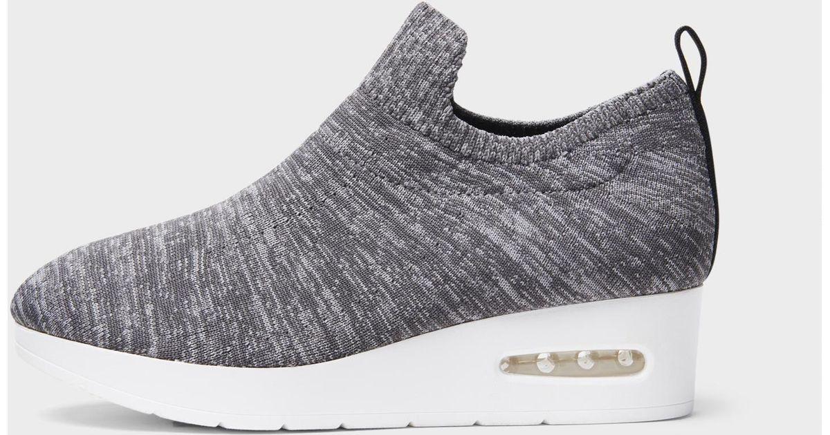7040da86b70 Lyst - DKNY Angie Slip On Low Wedge Sneaker in Gray
