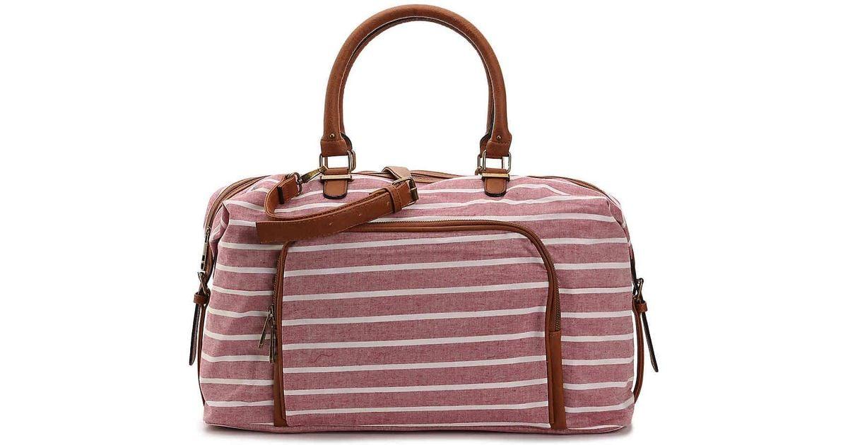 6087c458c823 Lyst - Madden Girl Glow Weekender Bag in Red