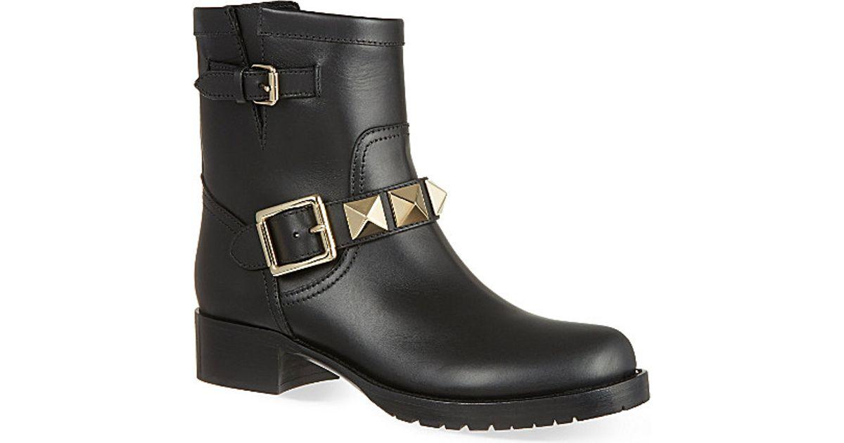 10c8a165b049 Lyst - Valentino Lock Stud Biker Boots in Black