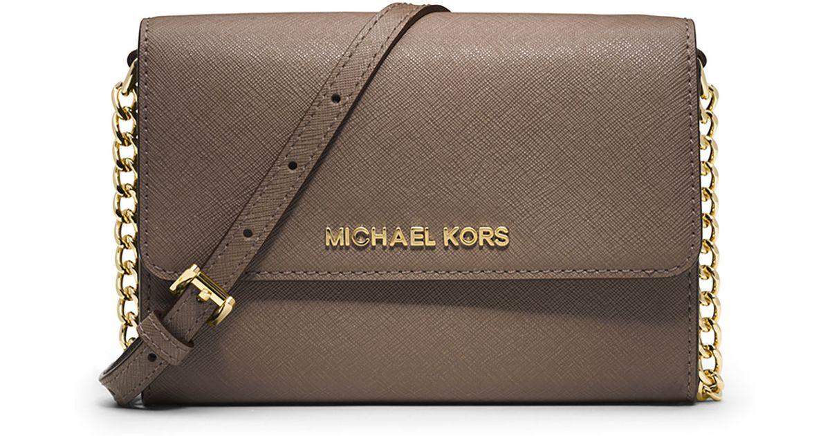 1c7556635583 Lyst - MICHAEL Michael Kors Jet Set Travel Crossbody Phone Case wallet in  Brown
