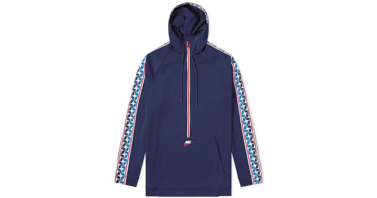 5330430dab Lyst - Nike Taped Poly Half Zip Hooded Sweat in Blue for Men