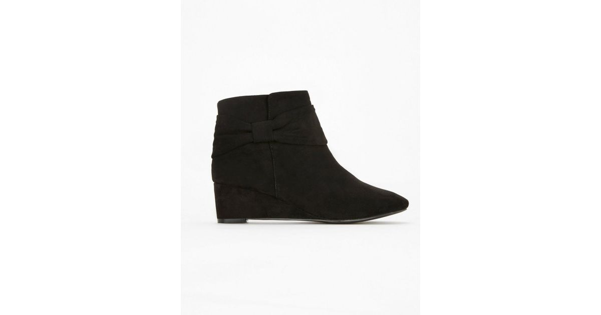 f3d4ec02763e Evans Extra Wide Fit Black Bow Wedge Ankle Boots in Black - Lyst