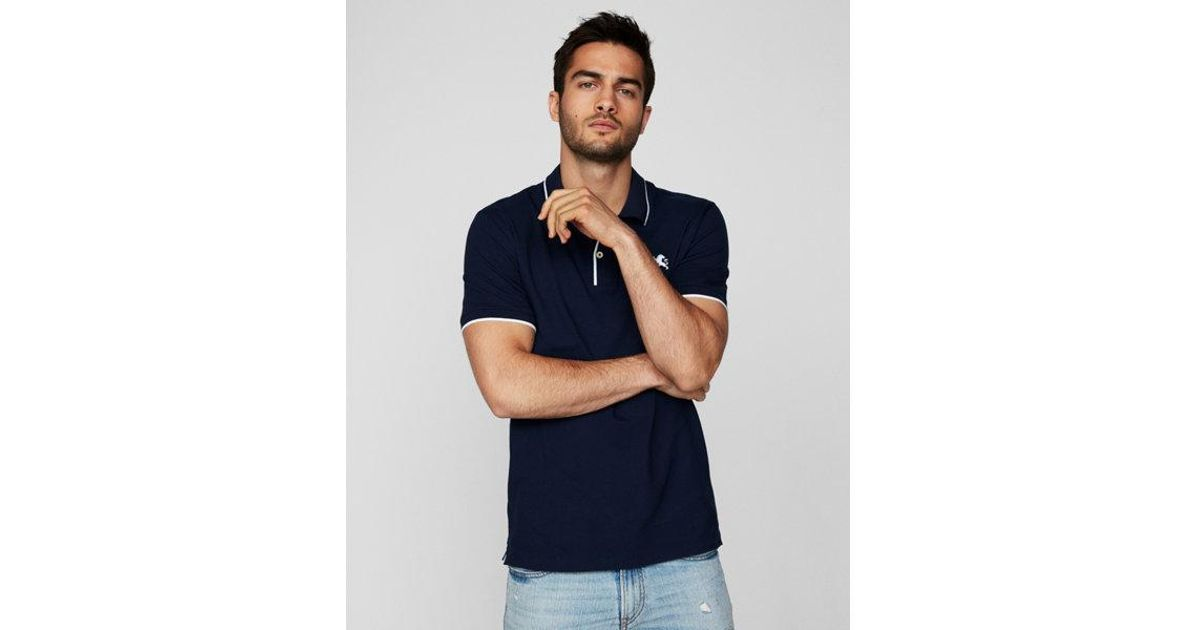 Lyst - Express Solid Tipped Small Lion Stretch Pique Polo in Blue for Men e2b0d56b2762c