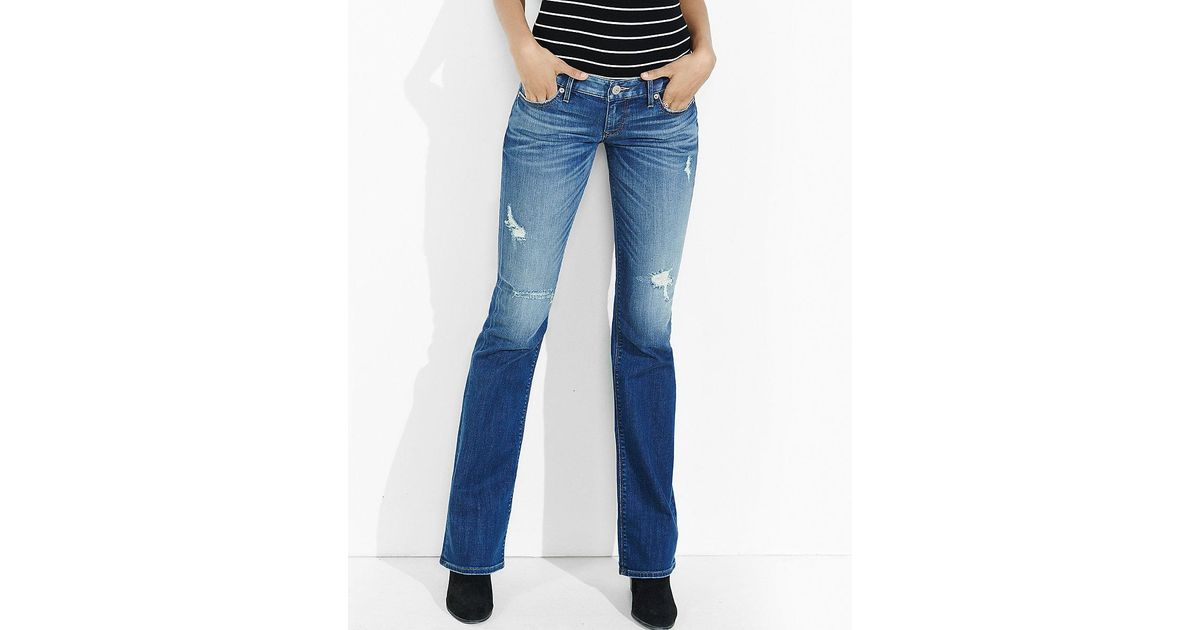 Lyst express distressed dark low rise bootcut jean in blue for Express wash roma