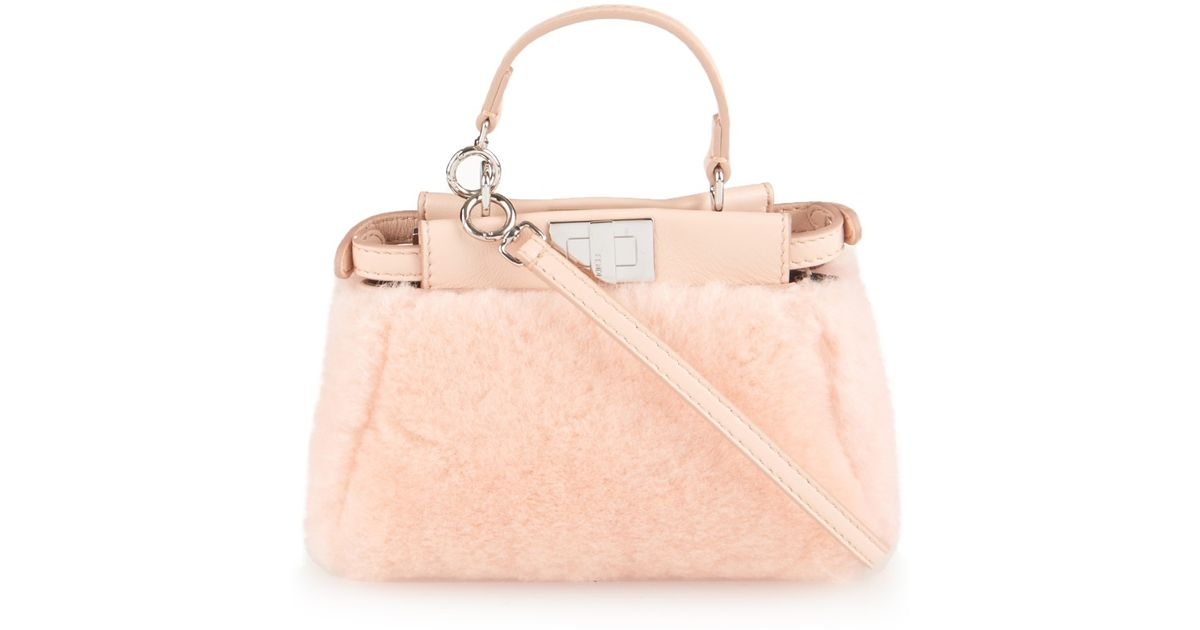 50b6c9d37a Lyst - Fendi Micro Peekaboo Shearling Cross-body Bag in Pink