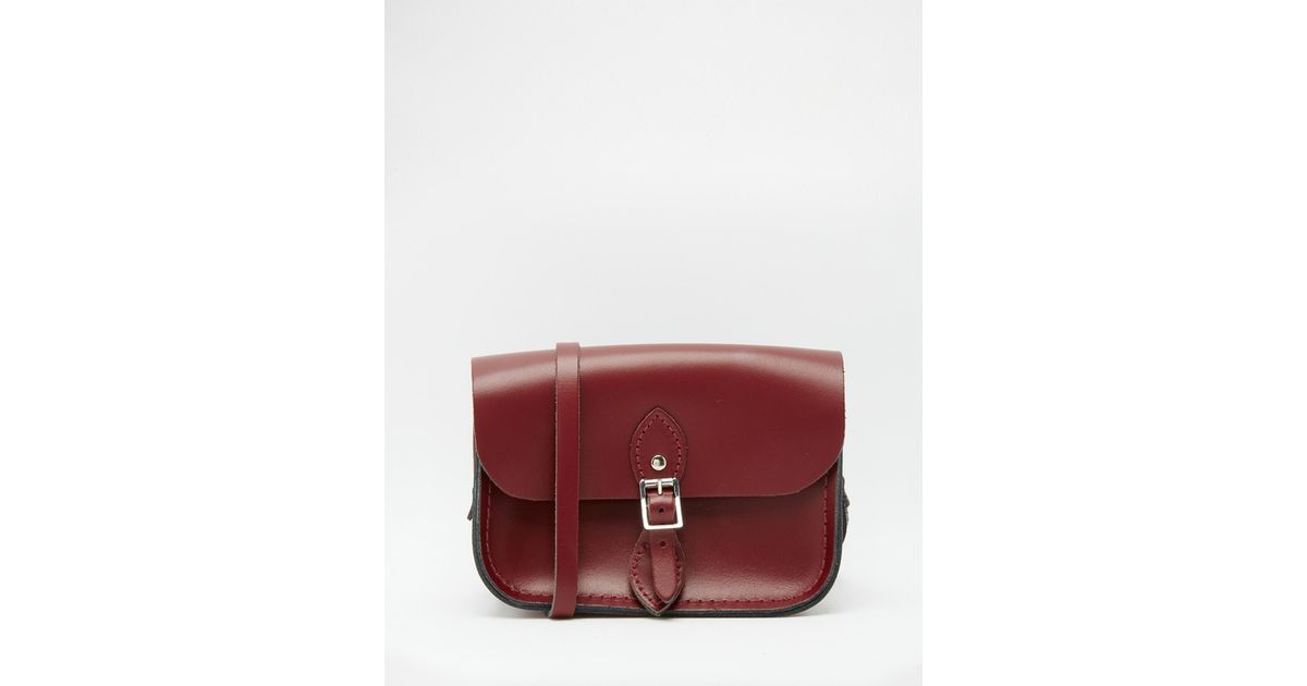 969addf589f Lyst - Cambridge Satchel Company The Leather Mini Traveller Bag In Oxblood  in Purple