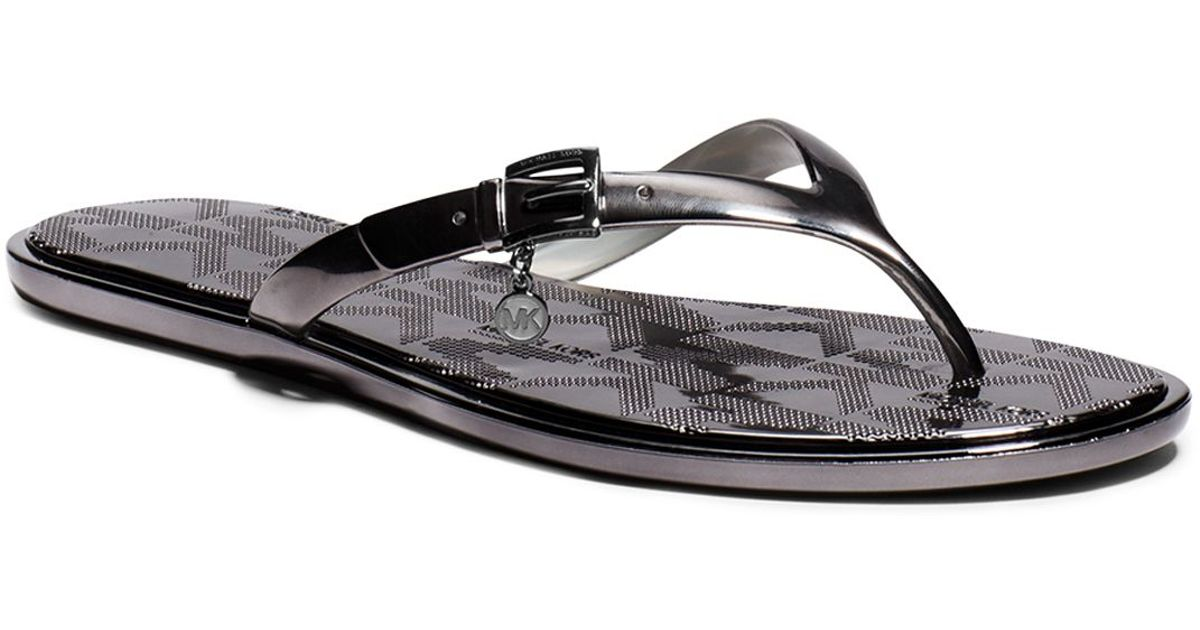 70cd666a06ed Lyst - MICHAEL Michael Kors Flip Flop Sandals - Emory Metallic Charm in  Black