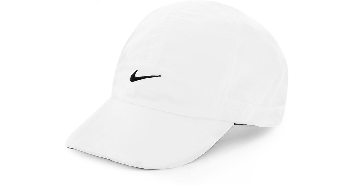 3f8b35b25bb92 ... cheap lyst nike featherlight 2.0 dri fit sports cap in white f8dcd 576a8