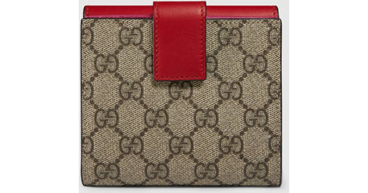 dc5161259925 Lyst - Gucci Gg Supreme French Flap Wallet in Red