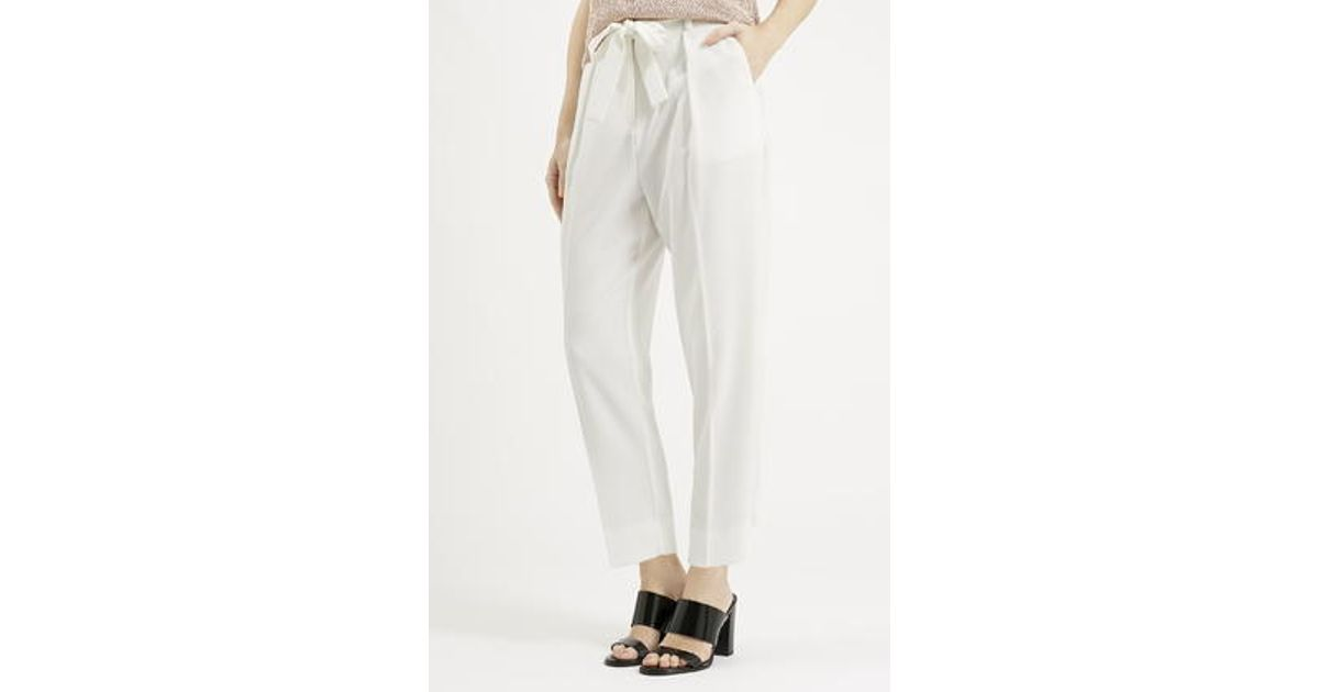 90ec2e23ef5 TOPSHOP Belted Crepe Peg Trousers in White - Lyst
