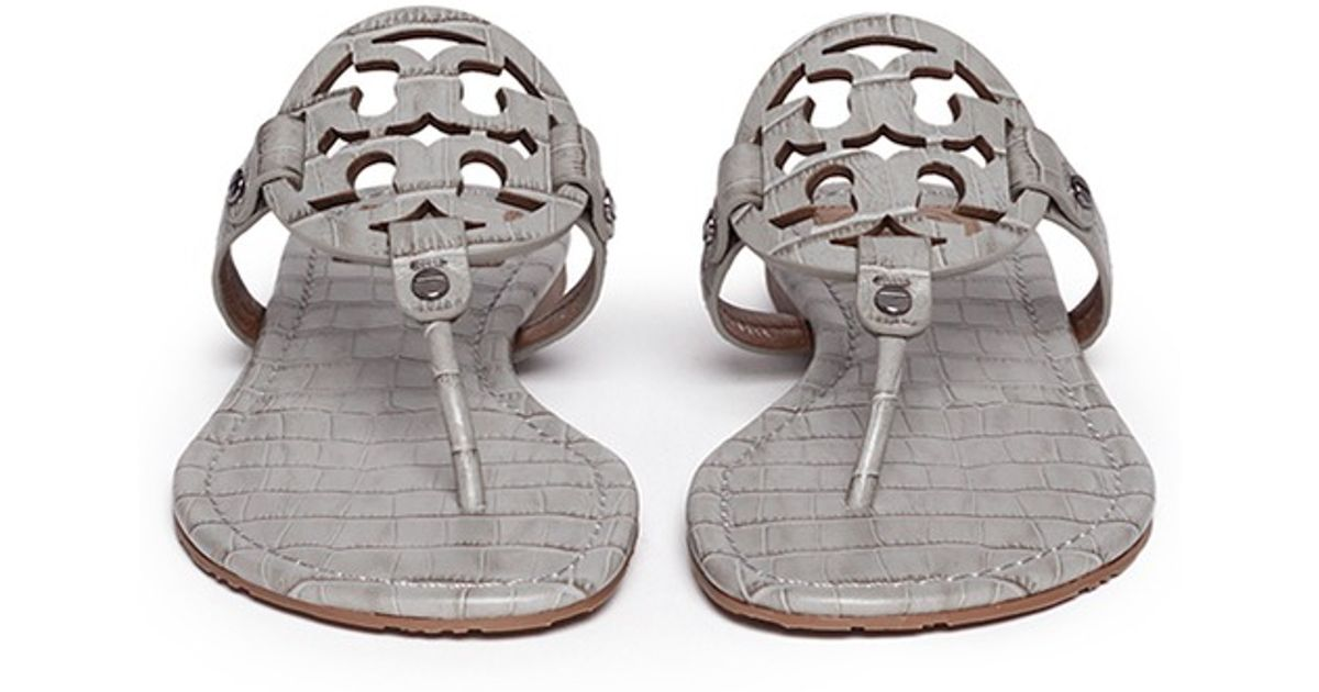 b7e115ed9d7f Lyst - Tory Burch  miller  Crocodile Print Thong Sandals in Gray