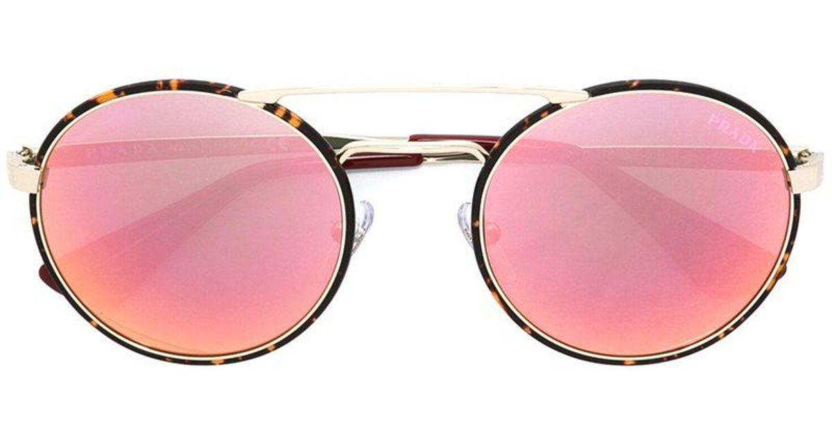 01b177f5acc1 Lyst - Prada Round Frame Sunglasses in Black