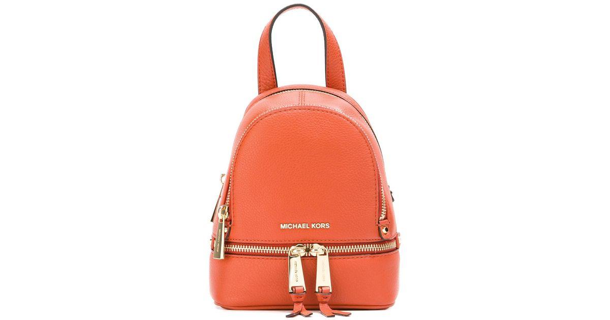 7a6f28400a47 MICHAEL Michael Kors Micro Rhea Backpack in Orange - Lyst